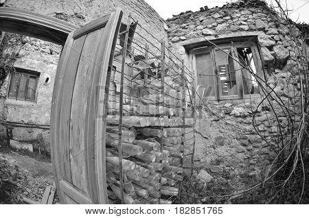 Abandoned cellar empty wine bottles black and white photo