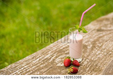 Fresh cold strawberry smoothies with fresh fruits. Strawberry smoothies strawberry detox strawberry milkshake. Strawberry milkshake with mint