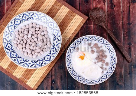 Purple Potato Dumplings With Poached Egg And Coconut Roll In Sweet Coconut Cream .