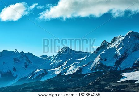 Snow capped mountains. Summits of the mountains. View of the Alpine mountains at the sunrise. Trek near Matterhorn mount.