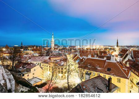 Traditional Old Ancient Architecture Cityscape In Historic District Of Tallinn, Estonia. Winter Evening Night. Famous Landmark. Destination Scenic.