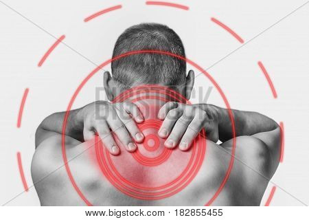 Unrecognizable man touching his neck acute pain rear view. Monochrome image isolated on a white background. Pain area of red color.