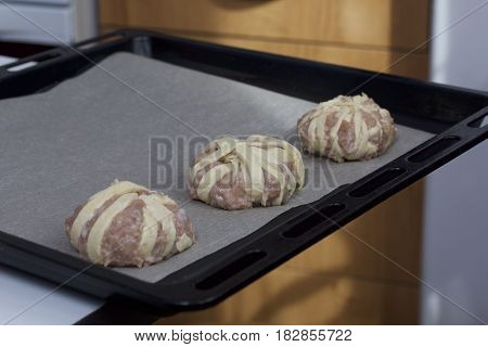 Stages Of Preparation Of Meat Glomeruli. The Blanks Are Laid Out On A Baking Tray Lined With Food Pa