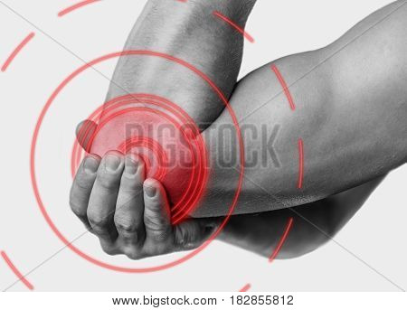 Acute pain in a male elbow. Monochrome image isolated on a white background. Pain area of red color.
