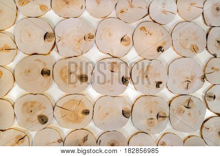 Pattern from many decorative interior unpolished alder wooden saw cuts with knots on white background.