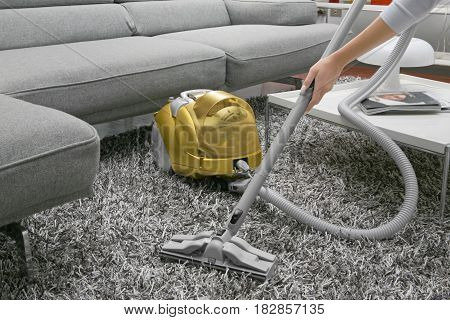 Woman use vacuum cleaner. cleaning of the apartment