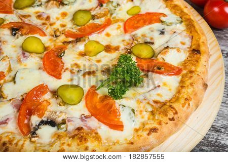 Pizza Meat With Cheese And Cucumber, With Rosemary And Spices On A Light Wooden Background. Italian