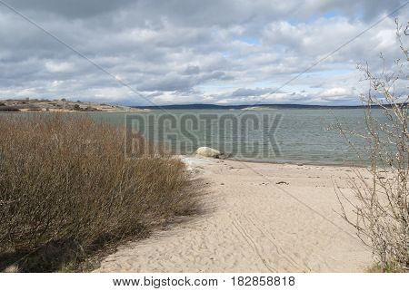 Sandy beach in Gothenburg in springtime, nature in Sweden