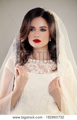 Perfect Fiancee Woman with Beautiful Hairstyle Make up Veil and Jewelry. Beautiful Bride in White Dress