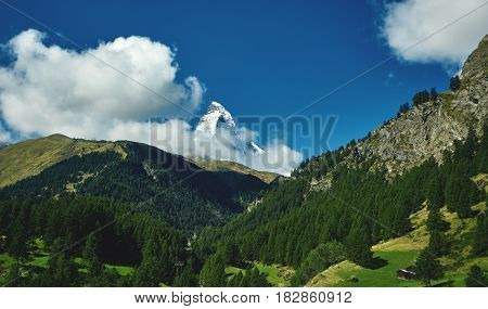 Snow capped mountains. View of the Matterhorn mount. Meadows and mountain ridge