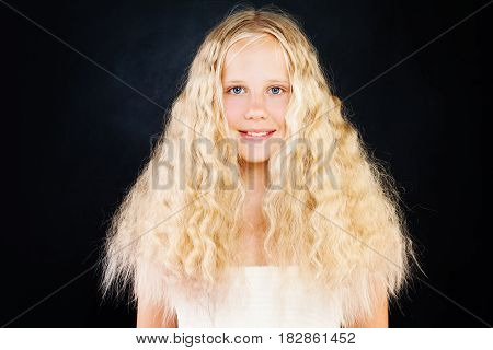 Cute Young Girl with Blonde Curly Hair. Blonde Teen Girl with Curly Hair on Dark Background