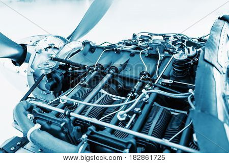 Aircraft engine detail. Piece of equipment of the aircraft engine closeup blue colored. View of an aircraft engine.