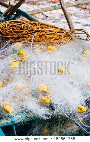 white fishing nets in the blue boat on the beach