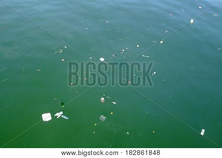 Water pollution, plastic bags, bottles and other garbage in ocean