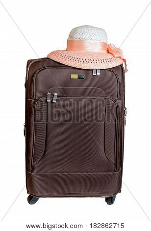 Brown suitcase and hat isolated on white background