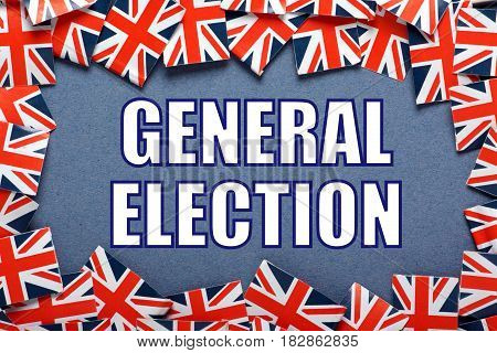 The words General Election in white text surrounded by union jack flags of the United Kingdom