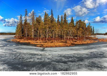 Spring landscape. Spilling the Pista River. Lake Hirvas. Russia. Karelia