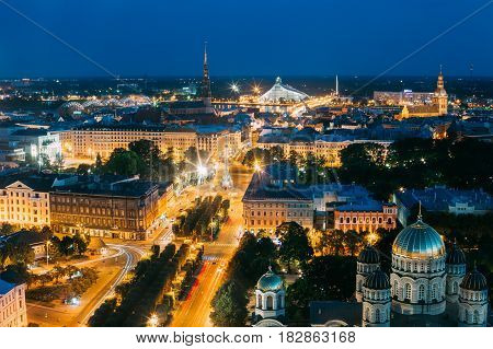 Riga, Latvia - July 2, 2016: Evening Night Aerial View Cityscape, Landmarks St. Peter's Church, Boulevard Of Freedom, Freedom Monument, National Library, Dome Cathedral, Nativity Of Christ Cathedral
