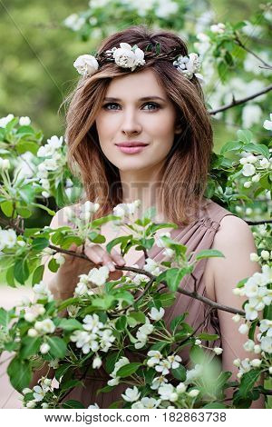 Beautiful Woman in Flowers Wreath. Long Bob Hairstyle Makeup and Flowers