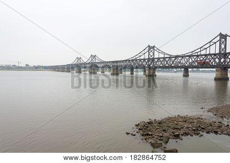 Liaoning, China - Jul 28 2015: China-north Korea Friendship Bridge. A Famous Historic Site In Dandon