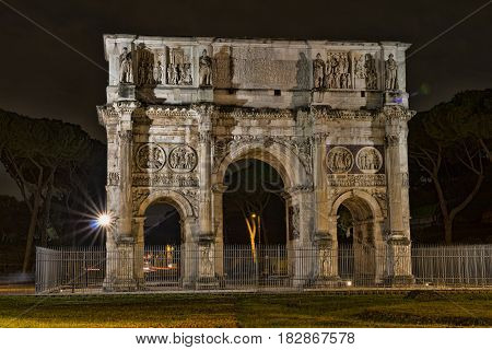 Arch of Constantine near the Colosseum at night. Rome, Italy.