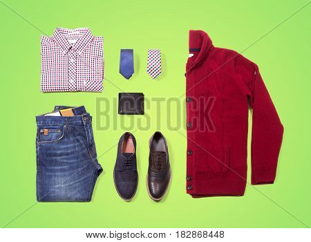 Denim layout clothes on green blackboard. en's layout clothes on green blackboard. Classic clothing. Shirt with tie, shawl, vest, belt and shoes