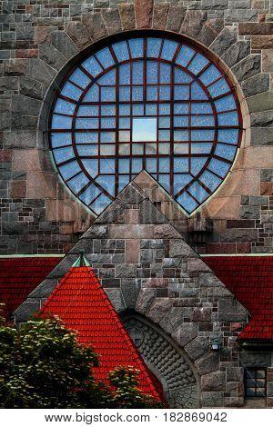 Old churchs round shape window in the evening light