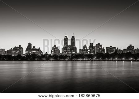 Upper West Side buildings and the Central Park Jacqueline Kennedy Onassis Reservoir at twilight (Black & White). Manhattan New York City