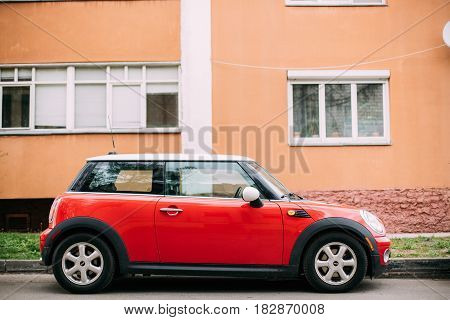 Gomel, Belarus - April 14, 2017: Red Color Car Mini Cooper Parked On Street Near Residential House