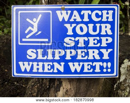 Watch your step slippery when wet sign