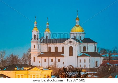 Vitebsk, Belarus. Evening Night View Of Famous Landmark Is Assumption Cathedral Church In Upper Town On Uspensky Mount Hill In Night Street Lights Illumination. Blue Hour Time