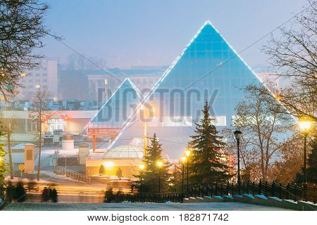 Vitebsk, Belarus - February 17, 2017: Shops In Pyramid Shape In Lenin Street At Winter Season. View From Gogol Street In Evening Or Night Illumination In Vitebsk, Belarus