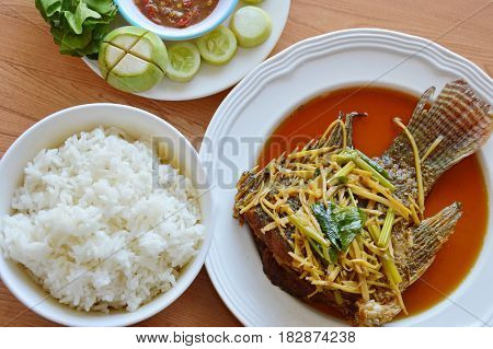 fried fish dressing ginger soy sauce eat with rice and spicy shrimp paste sauce
