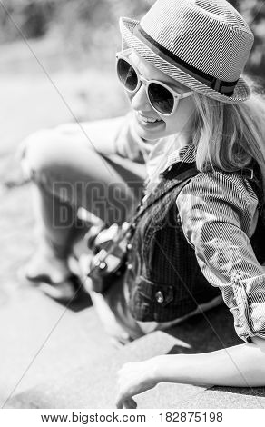 Smiling Young Hipster Sitting On Stairs Outdoors