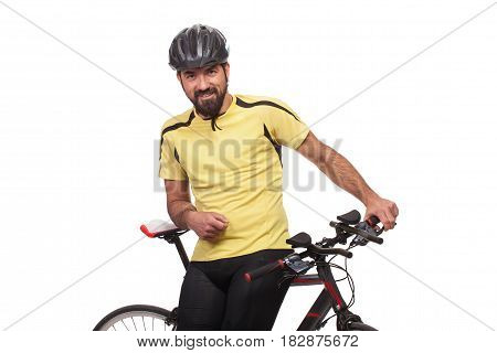 Portrait of smilling bicyclist with helmet and yellow shirt posing with a bicycle isolated on white