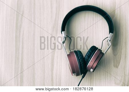 Wood office desk with headset headphone top veiw with copy space