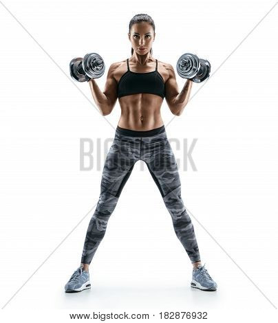 Beautiful young woman in training pumping up muscles of the back and hands with dumbbells. Photo athletic woman with perfect body isolated on white background. Strength and motivation