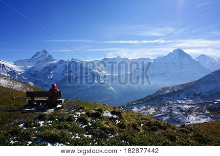 man relax resting on seating climbing the snow moutain with blue sky