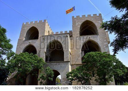Torres de Serrano or Serrans Gate with the flag of Valencia Spain.