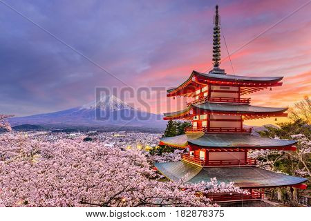 Fujiyoshida, Japan at Chureito Pagoda and Mt. Fuji in the spring with cherry blossoms.