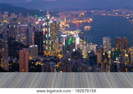 Opening wooden floor Aerial view blurred bokeh light Hong Kong city downtown at twilight abstract background