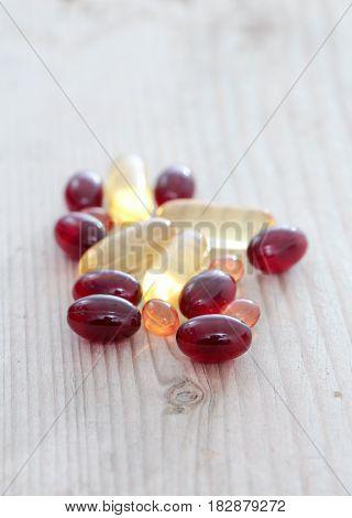 Pile Of Capsules Omega 3 On Wood Background. Close Up,