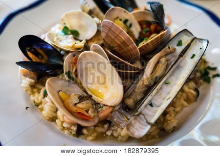 Italian delicious dish seafood risotto rice with various of mussels in Positano Italy