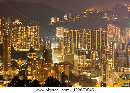Blurred bokeh light Hong Kong city residence building night view abstract background