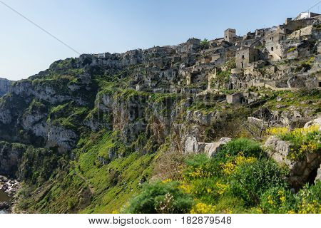 ancient ghost town of Matera (Sassi di Matera) in beautiful sun shine with blue sky southern Italy