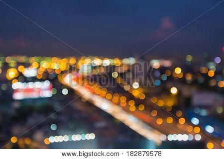 Aerial view night light city highway curved blurred bokeh light abstract background