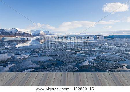 Opening wooden floor Jakulsarlon lagoon in winter season Iceland natural landscape background