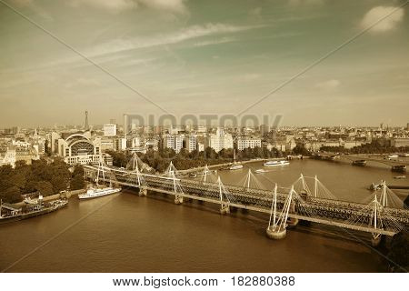City aerial view from London Eye over Thames River.