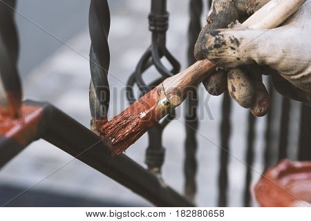 Painting Forged Railings On The Stairs At The Entrance Of The House. Protection Against Rust.