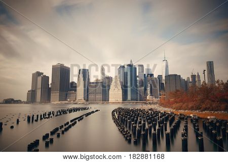 Downtown Manhattan skyline with pier wood log in New York City